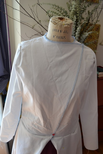 The bodice with the open skirt pinned